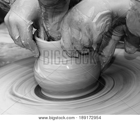 Beginner And Teacher In Process Of Making Clay Bowl On Pottery Wheel