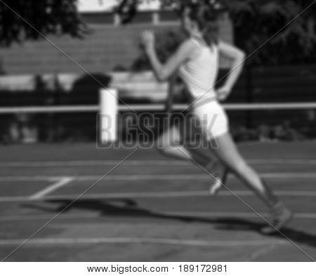 Black And White Blurred View Of Running Girl At Stadium