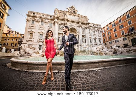 Beautiful couple dating in Rome Italy - Boyfriend and girlfriend at Trevi's fountain