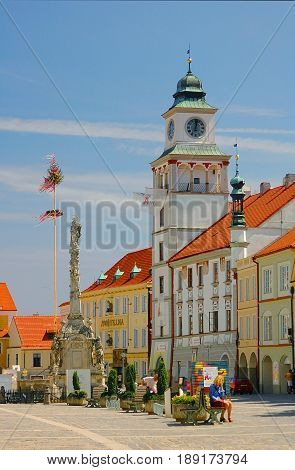 CZECH REPUBLIC, MAY 1, 2005: View on town square stela monument, orange roofs, bell clock tower, colorful buildings gingerbread houses. Classic european houses. Famous Czech sightseeing tours