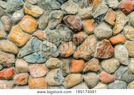 Rubble masonry wall. Stone wall made of various sizes stone can be used as background.