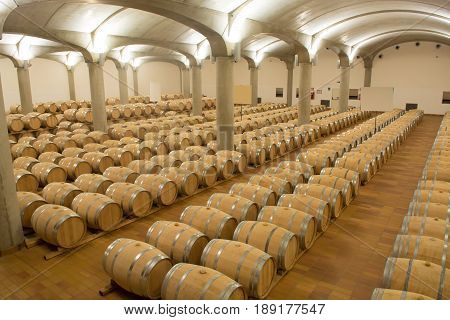 Wine barrels stacked in the cellar of the winery Marsala Sicily