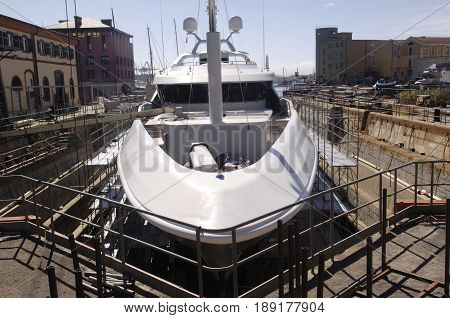 Repairing a battered yacht in the harbor Genoa Italy