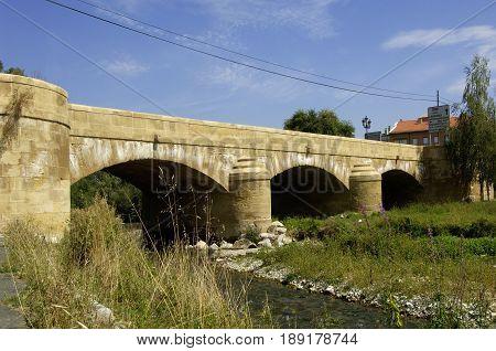 Oja river and medieval bridge of Casalareina La Rioja Spain