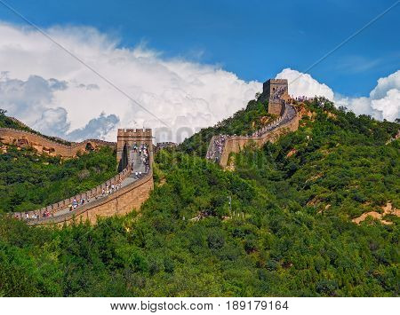 Perspective view on famous beautiful ancient Chinese Great Wall monument made of bricks stones. China architecture. China holidays vacation tours trips travel people tourists. Sightseeing point