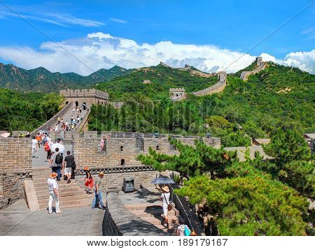 BEIJING, CHINA, AUG,28, 2016: Famous ancient Great Wall of China monument with walking people tourists. China architecture holidays tours travel tourism. Chinese sightseeing point tours