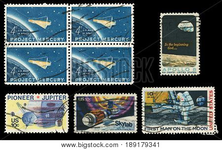 UNITED STATES OF AMERICA - CIRCA 1970S: Set of five USA space exploration postage stamps isolated on a black background