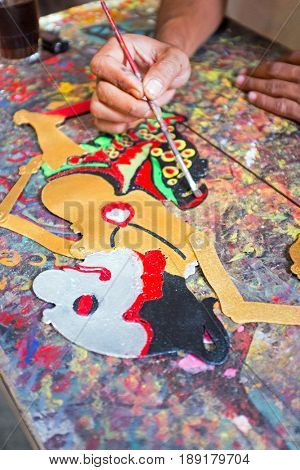 Making tradititional wajang puppet on Java Indonesia