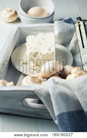Mushrooms, Cheese And Eggs In A White Wooden Box On A White Background
