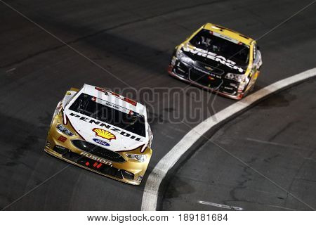 May 29, 2017 - Concord, NC, USA: Joey Logano (22) brings his car through the turns during the Coca Cola 600 at Charlotte Motor Speedway in Concord, NC.
