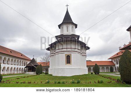 arched colonade and church of Sambata de Sus monastery in Transylvania Romania