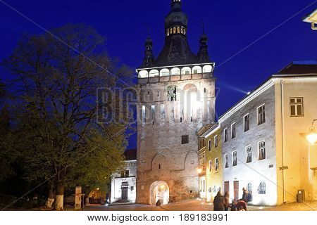 nignt at Unesco World Heritage Clock tower in Sighisoara Transylvania Romania