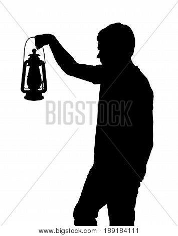 Silhouette Of Teenage Boy Holding Up Lantern