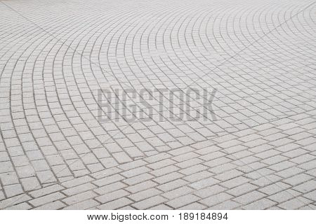 Background texture of a city paving stone on the whole frame