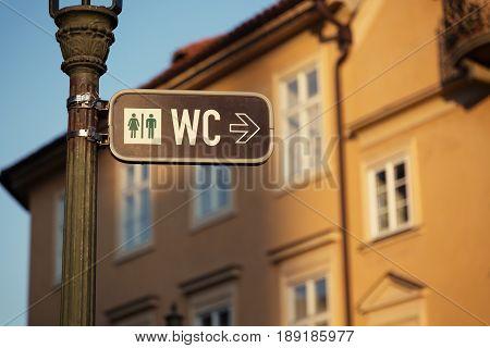 Sign for a toilet in Prague Czech Republic street.