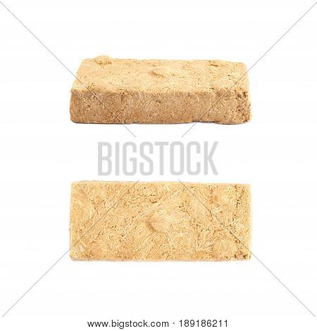 Briquette of a nut halva confection isolated over the white background, set of two different foreshortenings