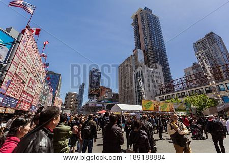 Toronto, Ontario, Canada, down town, May 20, 2017, great inviting view of down town Toronto dundas square on young street with various modern buildings and people walking in background