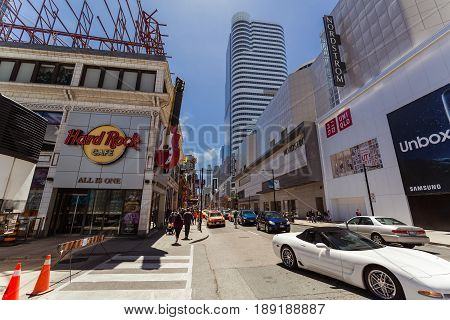 Toronto, Ontario, Canada, down town, May 20, 2017, great inviting view of down town Toronto young street with various modern buildings and people walking in background