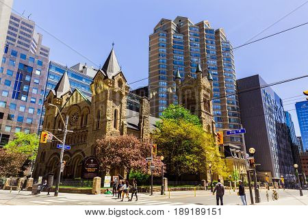 Toronto, Ontario, Canada, down town, May 20, 2017, nice beautiful view of old vintage Saint Andrew church and modern stylish architectural buildings in Toronto down town area on sunny day