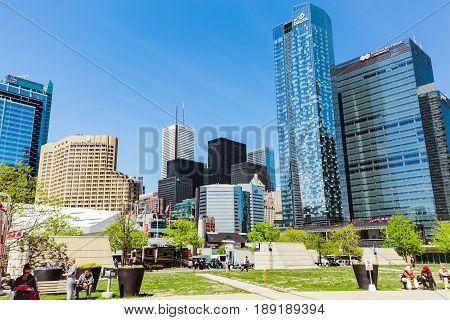 Toronto, Ontario, Canada, down town, May 20, 2017, amazing beautiful view of modern stylish architectural residential and office buildings in Toronto down town area with people relaxing in park