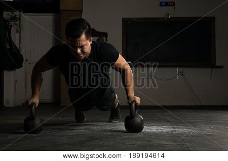 Doing Kettlebell Push-ups In A Gym