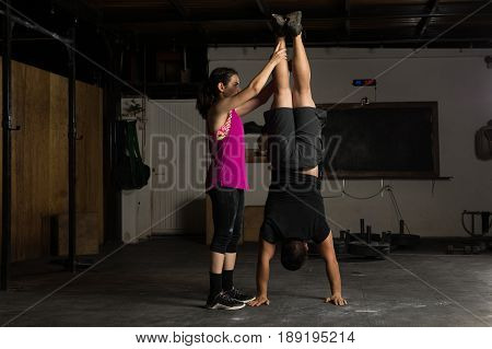 Woman Helping Out In A Gym