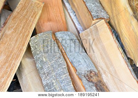 Neatly Stacked Firewood From Alder Wood On Full Frame Background
