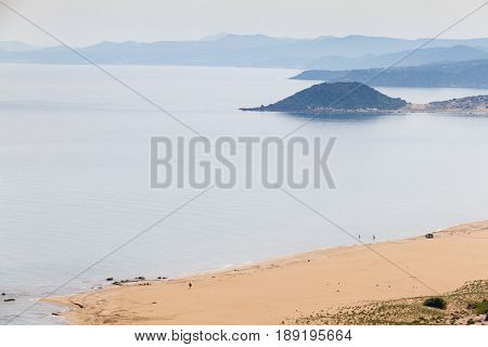 Golden beach or Turtle Beach in Karpasia Island of Cyprus near Apostolos Andreas monastery . View from the road passing above the beach area