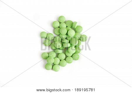 Green tablets isolated on white background. Green pills, prescription drugs on white background