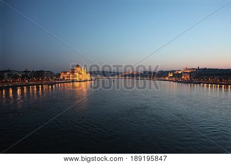 Budapest lights reflecting on the Danube at twilight
