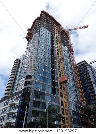 Downtown skyscrapers under construction in Seattle Washington USA clouds in the sky. June 2016.