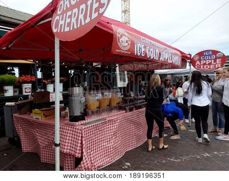 SEATTLE - JUNE 25: Cold Pressed Organic Ice Cold Apple Cider for sale at Pike Place Market in Seattle Washington on June 25 2016.