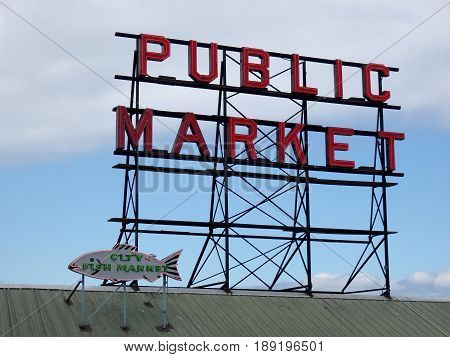 SeattleWashingtonusa. 06/25/16: Pike place Public marke and City Fish Market neon signs on top of building at during the day.
