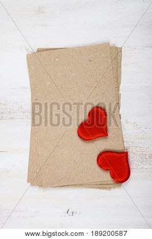 Paper, Gift And Hearts On A Wooden Background.