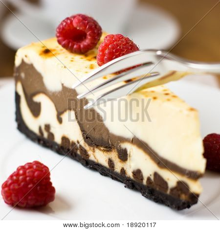 Close up of a delicious cheesecake with raspberries