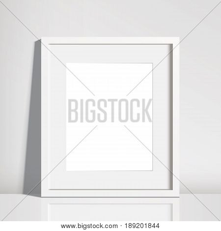 Realistic Empty White Picture Frame Mockup - 8x10 inch picture frame in portrait format. Isolated on a neutral off-white background with a subtle reflection. EPS10 file with transparency.