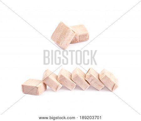 Pile of fruit flavoured chewing candies isolated over the white background, set of two different foreshortenings