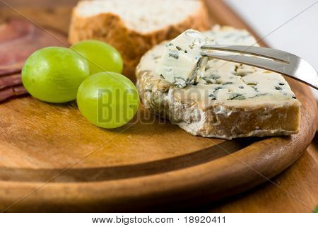 Fourme d'Ambert with grapes poster