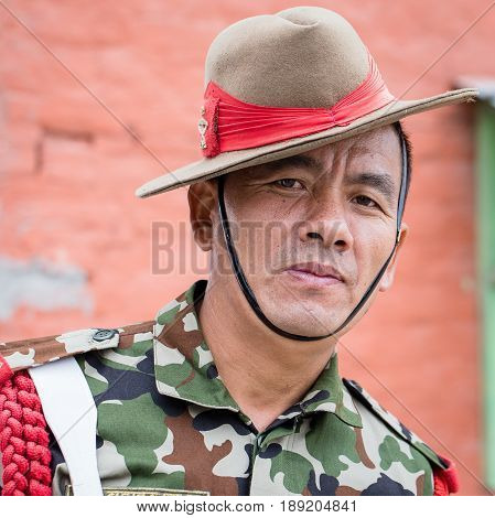 KATHMANDU NEPAL - SEPTEMBER 29 2016 : Portrait of a Gurkha warrior from the Nepalese Army in street Kathmandu .Gurkha warriors famous for their unquestionable loyalty ambition ferocity and resolve