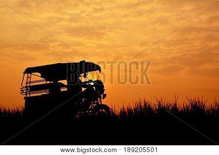 Silhouette of Tuk Tuk Thailand on sky sunset background