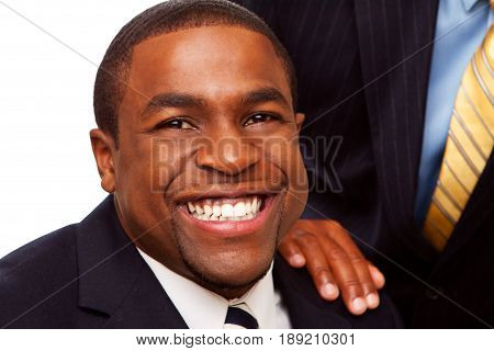 Mature African American Businessman mentoring a younger man.