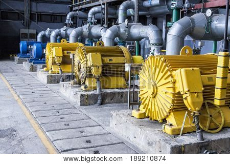 Large yellow Water pumps with electric motors