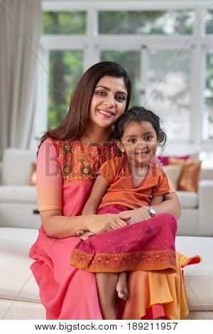 Hapy Indian mother and her little daughter wearing traditional clothes