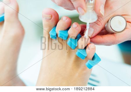People at work. Photo of pedicure procedure in process