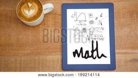Digital composite of Overhead view of various math equations in digital tablet by coffee cup at table