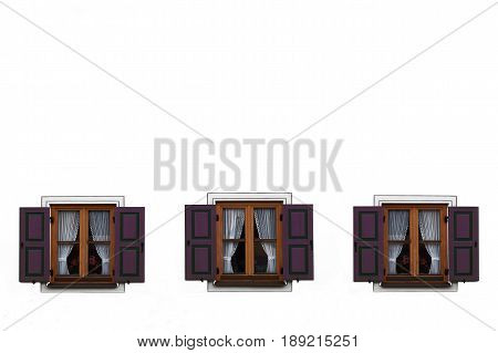 Three windows with purple shutters open. Empty space above.
