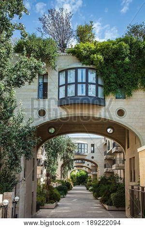 Elegant arched passageway between buildings. Jerusalem, Israel
