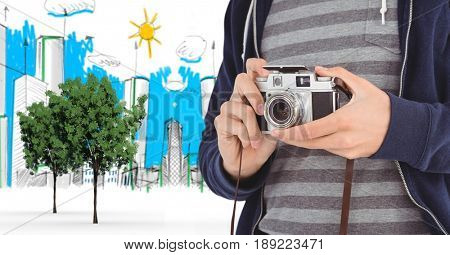 Digital composite of Digitally generated image of male tourist holding camera with buildings drawn in background