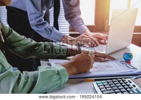 Business team meeting. Photo professional investor working new start up project.Analyzing income charts and graphs with modern laptop computer. Close up.Business analysis and strategy concept.