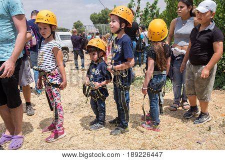 Children With Safety Equipment Waiting In Line For Zipline (zip-line)  Jumping